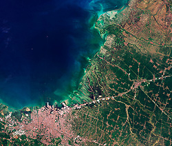 November 2, 2018 - Semarang, Indonesia - The Copernicus Sentinel-2B satellite takes us over Semarang, Indonesia. A port city on the north coast of Java, Semarang is the fifth-largest city in the country, covering some 374 sq km and home to just over 1.5 million people. This true-colour image shows the heart of the bustling regional commercial centre in the bottom-left. The Java Sea dominates the left part of the image. Flood management remains an ongoing challenge for the area, with the city being prone to tidal flooding. The island nation of Indonesia is particularly vulnerable to sea-level rise. Some parts of Semarang, such as the residential area of Candi Baru, shown in the bottom-left of the image, stand just above sea level. (Credit Image: © ESA/ZUMA Wire/ZUMAPRESS.com)