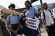 Following the attack on a group of Muslim men outside the Finsbury Park mosque which killed one person and seriously injured another ten, schoolgirls holding anti-racism and anti-terrorism messages are interviewed by the media, on 19th June 2017, in the borough of Islington, north London, England.