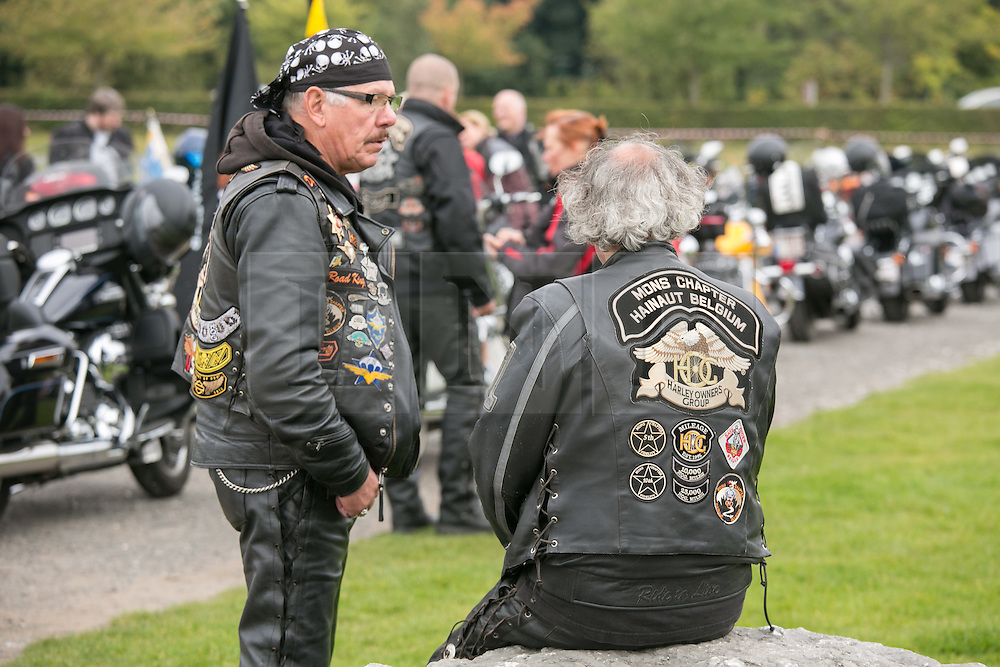 """© Licensed to London News Pictures. 3/10/2015, Tamworth, Staffordshire, UK. The eighth Ride to the Wall """"RTTW"""" took place today with thousands of motorcyclists arriving at the National Memorial Arboretum. Starting at eleven designated points around the country, the riders came from all over the UK as well as continental Europe.They rode to visit the walls of the Armed Forces Memorial where the names of 16,000 service men and women are engraved to remember those killed on duty or by terrorist action since the end of the Second World War. A display by the white helmets, tiger moth flypast and memorial service formed part of the day. Pictured, riders from Belgium taking part in the ride. Photo credit / Dave Warren/LNP"""