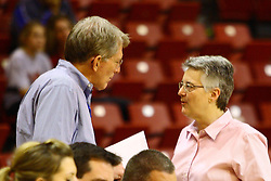 15 March 2012:  Judge (retired) Charles Witte speaks with Leanna Bordner during a first round WNIT basketball game between the Central Michigan Chippewas and the Illinois Sate Redbirds at Redbird Arena in Normal IL