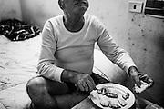 Anziano disabile in una abitazione abusiva all'interno del complesso popolare di Viale Morandi nel quartiere di Tor Sapienza, Roma 13 Novembre 2014.  Christian Mantuano / OneShot