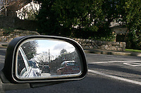 Reflection in car wing mirror, wintertime in Dublin Ireland