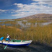 South America, Peru, Lake Titicaca. Boat on Lake Titicaca near Puno.