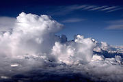 Thunderheads and lenticular clouds