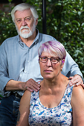 © Licensed to London News Pictures . 13/08/2017 . Salford , UK . Husband and wife Tony and Joy Watson (70 and 59 respectively) pictured in their garden in Eccles . Joy has Alzheimer's disease and has had to quit her job as a carer . As a campaigner and educator on the needs of people with dementia , she was praised by former Prime Minister David Cameron , who awarded her a Points of Light Award . But she and her retired husband and full-time carer, Tony, say they now struggle to pay their bills after an assessment by the DWP saw all their financial support withdrawn . For more information see http://www.mirror.co.uk/news/uk-news/woman-dementia-praised-david-cameron-10983661 . Photo credit : Joel Goodman/LNP