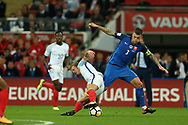Harry Kane of England is tackled by Martin Skrtel of Slovakia ®.  FIFA World cup qualifying match, European group F, England v Slovakia at Wembley Stadium in London on Monday 4th September 2017.<br /> pic by Andrew Orchard, Andrew Orchard sports photography.