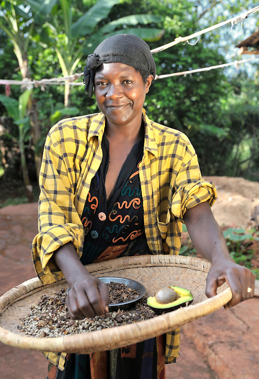 A woman and part of her coffee harvest in the Haitian village of Mizak.