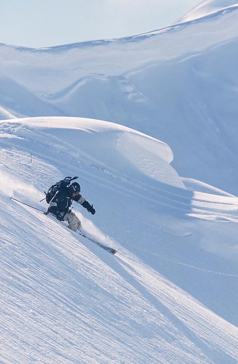 Alaska. Chilkat Range. Jim Conway rides his skis on a backcountry heli skiing trip, . MR