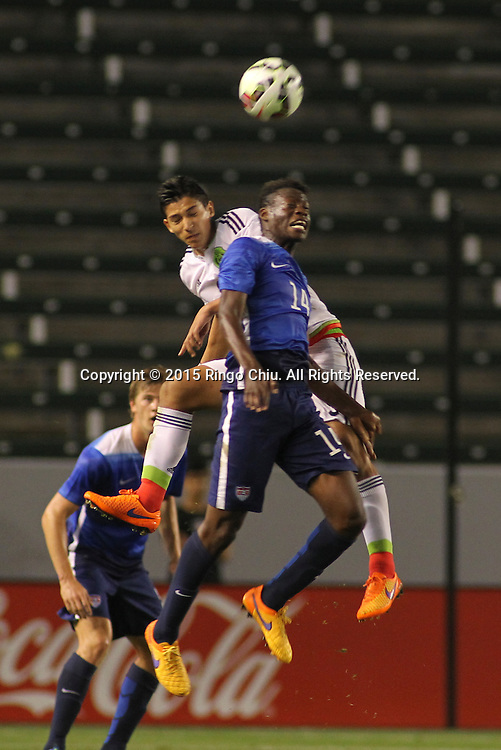 United States' Fatai Alashe #14 and Mexico's Marco Bueno #10 fight for a head ball during a men's national team international friendly match, April 22, 2015, at StubHub Center in Carson, California. United States won 3-0. (Photo by Ringo Chiu/PHOTOFORMULA.com)