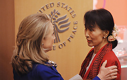 U.S. Secretary of State Hillary Clinton (L) welcomes Nobel Peace Prize winner and Burmese pro-democracy opposition leader Daw Aung San Suu Kyi to the United States Institute of Peace September 18, 2012 in Washington, DC. Photo by Olivier Douliery/ABACAUSA.com