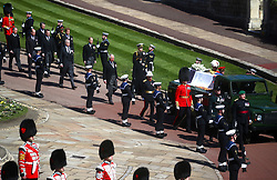The Duke of Edinburgh's coffin, covered with his Personal Standard, is carried on the purpose built Land Rover Defender followed by the Princess Royal, the Prince of Wales, the Duke of York, the Earl of Wessex, the Duke of Cambridge, Peter Phillips, the Duke of Sussex, the Earl of Snowdon and Vice Admiral Sir Timothy Laurence outside St George's Chapel, Windsor Castle, Berkshire, before the funeral of the Duke of Edinburgh. Picture date: Saturday April 17, 2021.