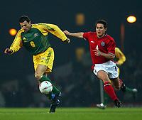 Photo. Javier Garcia<br />12/02/2003 England v Australia, Friendly International, Upton Park<br />Former Hammer Frank Lampard chases Australia's Josip Skoko