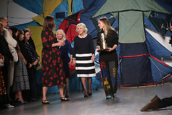 The Duchess of Cornwall presenting the Queen Elizabeth II Award for British Design to Bethany Williams during the Autumn/Winter 2019 London Fashion Week show at the BFC Show Space, London.
