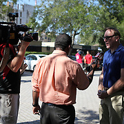 Lew Oliver, Chairman of the Republican Party of Orange County speaks with the media, at the Winter Park Public Library in Winter Park, Florida on Sunday, November 4, 2012. A Florida judge granted extended early voting hours after two suspicious devices closed the Winter Park Library for several hours Saturday. (AP Photo/Alex Menendez)