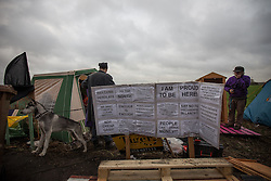 © Licensed to London News Pictures . 27/11/2013 . Manchester , UK . Tents pitched alongside the access road leading to the site . Energy firm IGas have today (Wednesday 27th November 2013) been receiving drilling equipment in readiness for exploratory drilling at the site . Anti fracking protesters have established a camp at Barton Moss in Greater Manchester alongside an access road leading to an IGas drilling site .  Photo credit : Joel Goodman/LNP