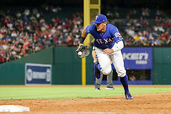 May 22, 2018 - Arlington, TX, U.S. - ARLINGTON, TX - MAY 22: Texas Rangers first baseman Ronald Guzman (67) grabs the baseball and slides to a stop and turns and runs towards first base during the game between the Texas Rangers and the New York Yankees on May 22, 2018 at Globe Life Park in Arlington, Texas. The Rangers defeat the Yankees 6-4. (Photo by Matthew Pearce/Icon Sportswire) (Credit Image: © Matthew Pearce/Icon SMI via ZUMA Press)