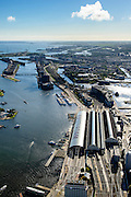Nederland, Noord-Holland, Amsterdam, 27-09-2015; stadsdeel Centrum. Amsterdam Centraal Station en Oosterdokseiland gezien naar voormalige Oostelijk Havengebied (Zeeburg). IJ met IJ-oevers, Ijburg aan de horizon.<br /> Urban and city development, immediately east of Central Station (foreground).<br /> luchtfoto (toeslag op standard tarieven);<br /> aerial photo (additional fee required);<br /> copyright foto/photo Siebe Swart