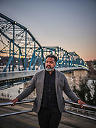 """CHATTANOOGA, Tenn. - March 4, 2021: Donivan Brown, a speaker, organizer, and equity trainer, poses for a portrait near the Walnut Street Bridge where Ed Johnson, a Black man wrongfully accused of raping a White woman, was lynched in 1906. """"I really don't feel comfortable walking the bridge,"""" said Brown. """"I felt as if by walking across the bridge that it was some sort of affirmation of silence or the fact that it's a playground now.""""<br /> <br /> (Photo by William DeShazer for The Washington Post)"""