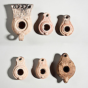 6 Jewish Beit Nataf type Terracotta oil lamps 4tg century CE. Menorah can be seen depicted bottom right