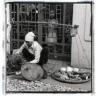 Portrait of a Vietnamese street vendor selling veggies, Hanoi,Vietnam, Southeast Asia
