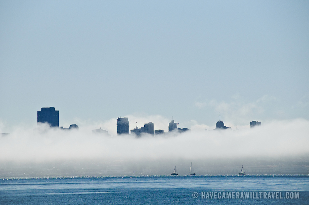 City of San Francisco partially obscured by fog. Photo taken across the bay at Sausalito.