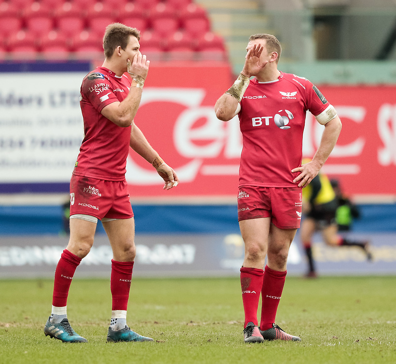 Scarlets' Liam Williams with team-mate Hadleigh Parkes<br /> <br /> Photographer Simon King/CameraSport<br /> <br /> European Rugby Champions Cup Pool 3 - Scarlets v Saracens - Sunday 15th January 2017 - Parc y Scarlets - Llanelli <br /> <br /> World Copyright © 2017 CameraSport. All rights reserved. 43 Linden Ave. Countesthorpe. Leicester. England. LE8 5PG - Tel: +44 (0) 116 277 4147 - admin@camerasport.com - www.camerasport.com