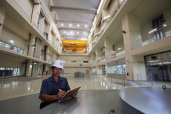 Mr.Chansamone CHANTHAVONGSA, an operator in the turbine hall of the Nam Ngum 2 hydro dam in Vientiane Province. Lao PDR