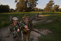 Collin Wood (left), Lionel Swift and Robert Hodder (behind) move to their positions for the afternoon shoot. Duck hunting season openning weekend on the Murray River near Howlong. Pic By Craig Sillitoe CSZ/The Sunday Age 22/3/2011 This photograph can be used for non commercial uses with attribution. Credit: Craig Sillitoe Photography / http://www.csillitoe.com<br /> <br /> It is protected under the Creative Commons Attribution-NonCommercial-ShareAlike 4.0 International License. To view a copy of this license, visit http://creativecommons.org/licenses/by-nc-sa/4.0/.