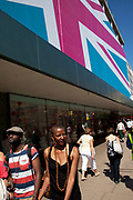 The colourful West End prepares for the Olympic 2012 Games with a giant Union Jack flag covering the John Lewis department store on Oxford Stree, London, UK.