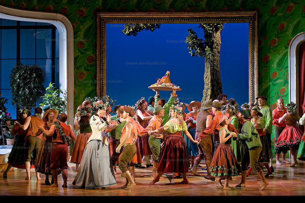 Picture shows : Kate Val entine (white dress) as Karolina with the chorus...Picture  ©  Drew Farrell Tel : 07721 ?735041.THE TWO WIDOWS by  Smetana.A SCOTTISH OPERA AND EDINBURGH INTERNATIONAL FESTIVAL CO-PRODUCTION.Premiering at the Edinburgh International Festival, this brand new production stars Scottish soprano Kate Valentine and internationally renowned mezzo Jane Irwin..The directorial partnership between Tobias Hoheisel and Imogen Kogge transforms this delicate comedy into something that digs deeper without losing its inherent charm. Francesco Corti conducts this, his first production as Music Director of Scottish Opera...Kate Valentine as Karolina Záleská.Jane Irwin as Ane?ka Miletinská?Nicholas Folwell as Mumlal?David Pomeroy as Ladislav Podhajsky?Ben Johnson as Toník, a peasant?Rebecca Ryan as Lidka, a maid.?Conductor..Francesco Corti.Directors ..         Tobias Hoheisel & Imogen Kogge.Designer..         Tobias Hoheisel.Lighting..         Peter Mumford.Choreographer  .Kally Lloyd-Jones.Dramaturg..Micaela von Marcard..Performances :.Edinburgh Festival Theatre?9 ? 11 ? 12  August?Theatre Royal, Glasgow?10 ?  14 ? 17 ? October?Note to Editors:  This image is free to be used editorially in the promotion of Scottish Opera and The Edinburgh International Festival. Without prejudice ALL other licences without prior consent will be deemed a breach of copyright under the 1988. Copyright Design and Patents Act  and will be subject to payment or legal action, where appropriate..Further further information please contact Kerryn Hurley Scottish Opera Press Manager t:   0141 242 0511. Or contact The Edinburgh International Festival Press Office  +44 (0)131 473 2020.