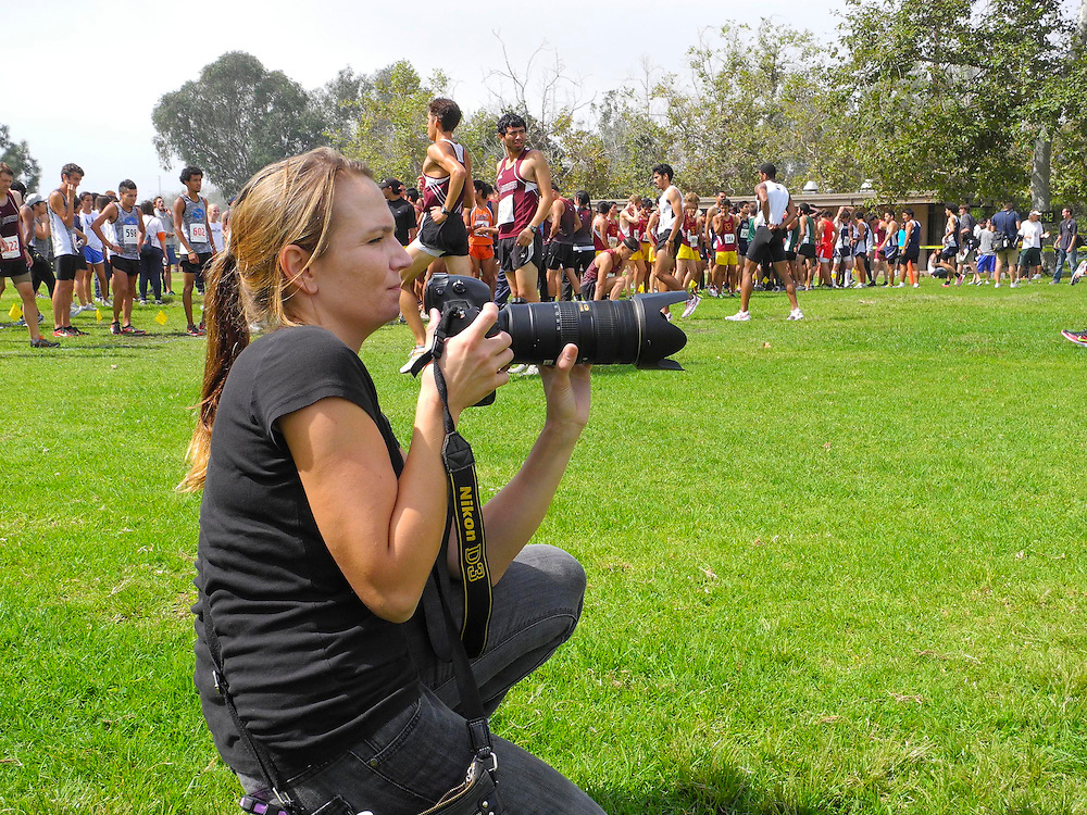 9/22/11 --- SPORTS SHOOTER ACADEMY --- Sports Shooter Academy XIII participant Carrie Jesenovec waits for the start of a cross country meet. Photo by Robert Hanashiro, Sports Shooter Academy Behind the Scenes with the cast and crew of Sports Shooter Academy.