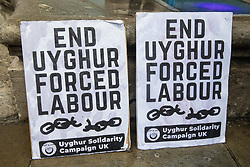 London, UK. 5th August, 2021. Uyghur Solidarity Campaign UK placards are pictured at a protest opposite the Chinese embassy in support of the Uyghur people's struggle for freedom. Activists at the protest highlighted the Chinese government's persecution and forced assimilation of Uyghurs, Kazakhs and other indigenous people in East Turkestan and Xinjiang and called for them to have the right to determine their own futures through a democratic process.