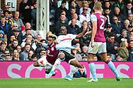 Fulham striker Sone Aluko (24) tackles Aston Villa defender Jordan Amavi (23) during the EFL Sky Bet Championship match between Fulham and Aston Villa at Craven Cottage, London, England on 17 April 2017. Photo by Jon Bromley.