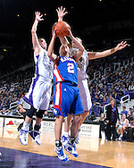 Kansas guard Kelly Kohn (2) goes up for a shot under pressure from Kansas State defenders Claire Coggins (14) and Shalee Lehning (5), during the first half at Bramlage Coliseum in Manhattan, Kansas, January 24, 2007.  K-State leads the Jayhawks at halftime 36-29.