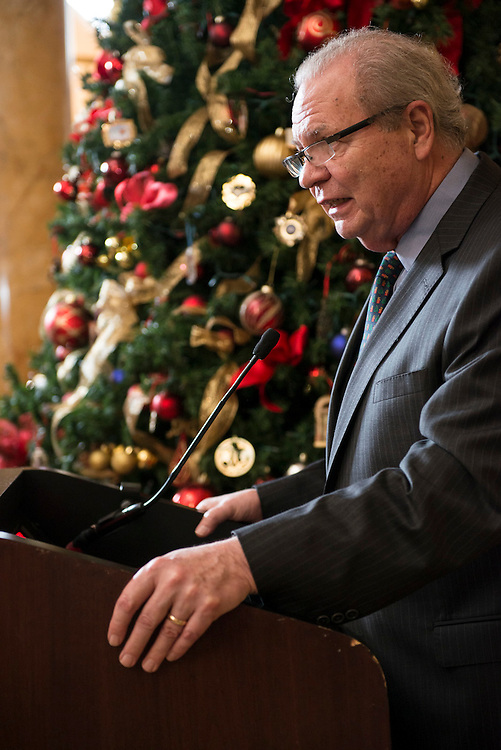 """Neil Horstman, President of the White House Historical Association, gave remarks at the Willard InterContinental's Holiday Tree Lighting on December 5, 2013. Beginning in 2012, the WHHA and the Willard have partnered for a holiday tree lighting, highlighting the WHHA's annual White House Christmas Ornament. 32 years of WHHA ornaments decorated this year's tree, including the 2013 ornament honoring President Woodrow Wilson. Wilson, known as the """"President of Peace,"""" founded the League of Nations at the Willard, providing a very special connection for the partnering organizations. (Photo by Matthew Paul D'Agostino / WHHA)"""
