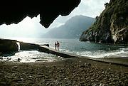 Italy, Amalfi Coast, Positano, Couple on rocky beach.