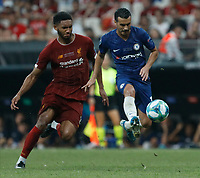 ISTANBUL, TURKEY - AUGUST 14: Joe Gomez (L) of Liverpool and Pedro of Chelsea vie for the ball during the UEFA Super Cup match between Liverpool and Chelsea at Vodafone Park on August 14, 2019 in Istanbul, Turkey. (Photo by MB Media/Getty Images)