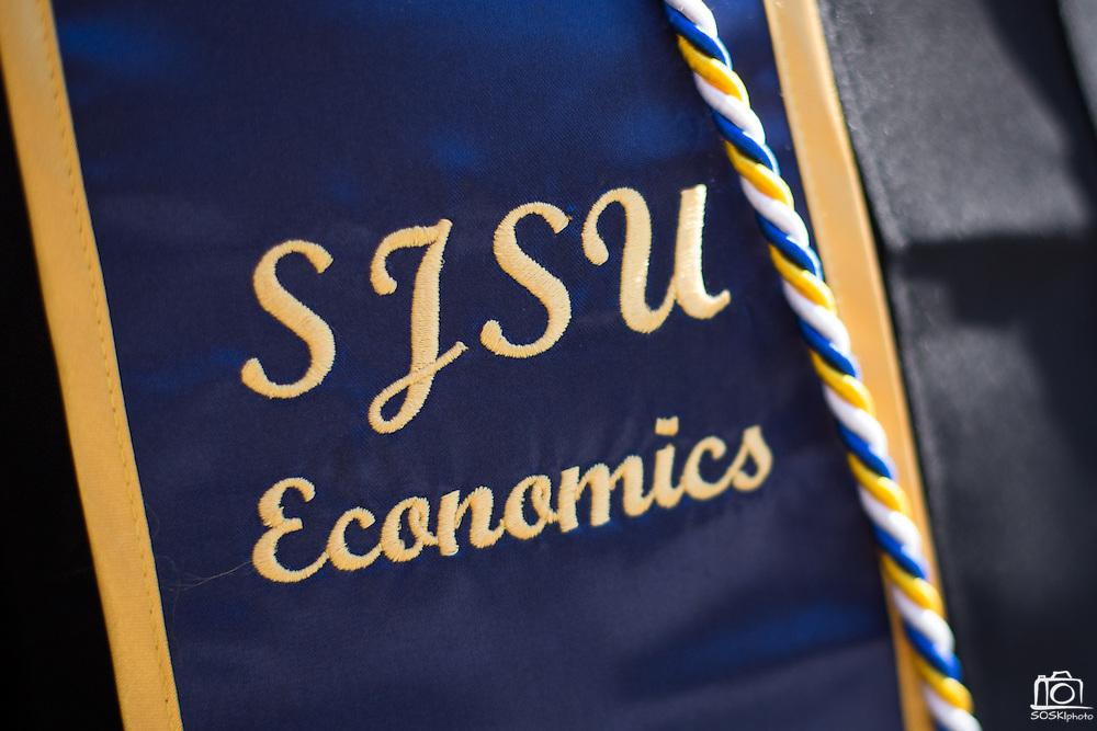 San Jose State students celebrate during the Economics convocaton at San José State University's Music Concert Hall in San Jose, California, on May 23, 2013. (Stan Olszewski/SOSKIphoto)