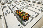 Wreaths of flowers lay on one of several identical tombs at the Necropolis Cristobal Colon cemetery in Havana, Cuba on Saturday June 28, 2008.