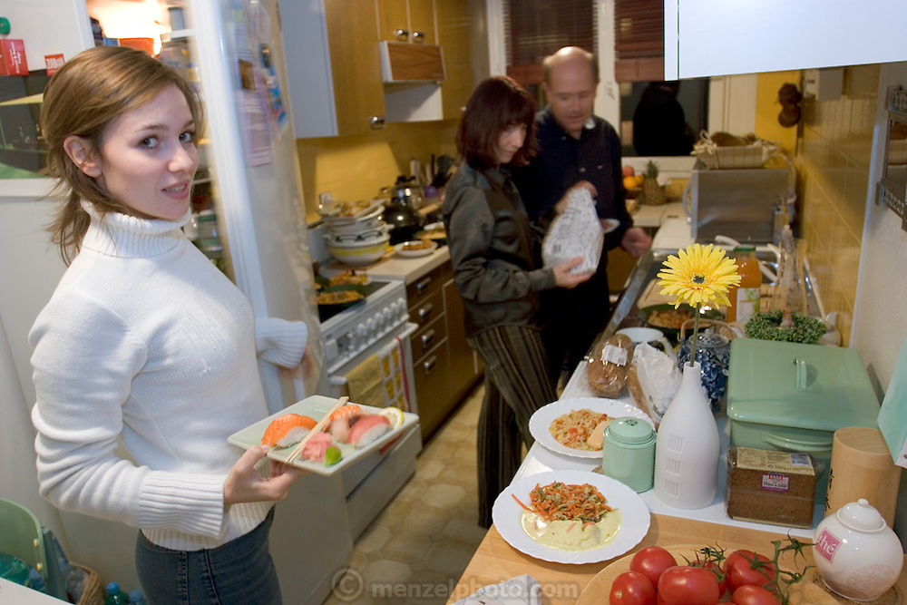 (MODEL RELEASED IMAGE). After the family food portrait the Le Moines gamely tried to use up as much of the perishable food as possible in that night's supper. (Supporting image from the project Hungry Planet: What the World Eats.) The Le Moine family lives in the Paris suburb of Montreuil, France, and is one of the thirty families featured, with a weeks' worth of food, in the book Hungry Planet: What the World Eats.