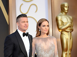 Brad Pitt and Angelina Jolie arriving to the 2014 Oscars at the Hollywood and Highland Center in Hollywood, California, USA,  Sunday, 2nd March 2014. Picture by Hollywood Bubbles / i-Images<br /> UK ONLY