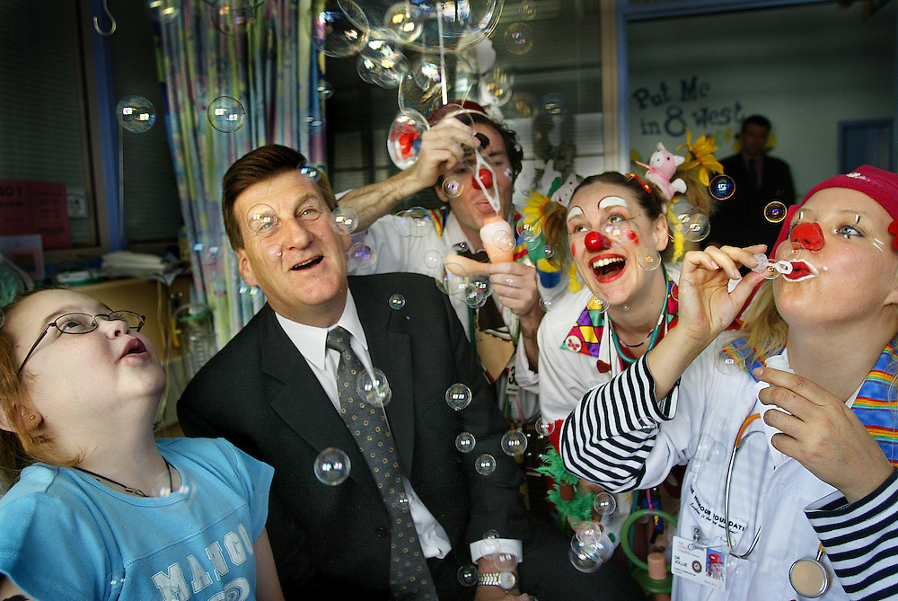 csz021203.001.001.jpg. Digicam000. 11 year old Elke Bullen is suffering from cistic fibrosis but is being cheered up by clown doctors (left to right), Dr Doctor, Dr Pollywaffle, and Dr Jollie and their patron Jeff Kennet. Pic By Craig Sillitoe melbourne photographers, commercial photographers, industrial photographers, corporate photographer, architectural photographers, This photograph can be used for non commercial uses with attribution. Credit: Craig Sillitoe Photography / http://www.csillitoe.com<br /> <br /> It is protected under the Creative Commons Attribution-NonCommercial-ShareAlike 4.0 International License. To view a copy of this license, visit http://creativecommons.org/licenses/by-nc-sa/4.0/.