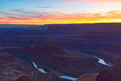 Sunset at Dead Horse Point near Moab Utah. Dead Horse Bend is  very cool slice in the earth carved by the Colorado River.