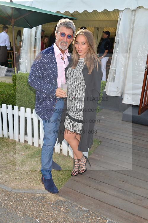EDDIE JORDAN and CHLOE GREEN at the Laureus Polo held at Ham Polo Club, Ham, Richmond, Surrey on 18th June 2015.