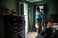 Victoria Ardoin inside the DeBate's home helping the family gather some things after the flood waters in Denham Springs Louisiana started to go down. The DeBate's didn't find much that they could rescue.