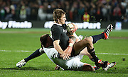 Beauden Barrett of the All Blacks is tackled by Joe Marler of England  during the third rugby test between the All Blacks and England played at Waikato Stadium in Hamilton during the Steinlager Series - All Blacks v England, Hamiton, 21 June 2014<br /> www.photosport.co.nz