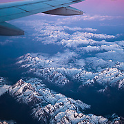 A view the snowy Swiss and French Alps from above at sunset.<br />
