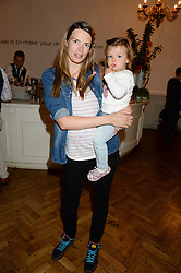 CAMILLA SIMON and her daughter INDIANA at a children's tea party to celebrate the 80th anniversary of iCandy - the luxury British pushchair brand held at One Marylebone, Marylebone Road, London NW1 on 10th September 2013.