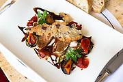 Meal of lamb with roasted vegetables and balsamic vinegar in Cafe-Bistro at Dallmayr food store in Munich, Bavaria, Germany