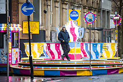© Licensed to London News Pictures . 26/01/2020. Manchester, UK. A fairground attraction operative waits for customers on Princess Street . Thousands of people watch a display of oriental culture and a procession through Manchester city centre to mark Chinese New Year . Photo credit: Joel Goodman/LNP